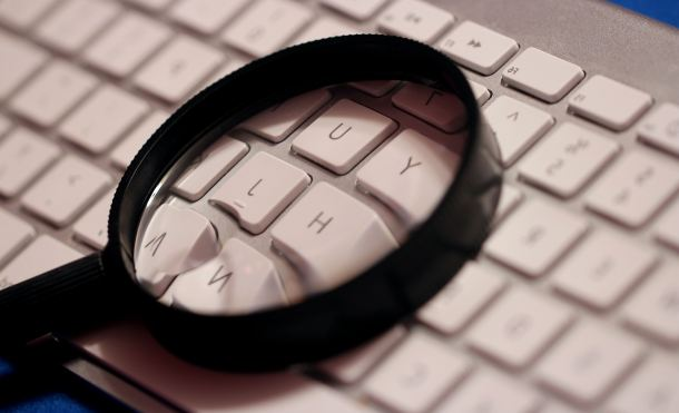 magnifying-glass-atop-computer-wireless-keyboard